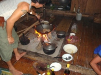 our host cooking dinner