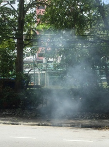Routine garbage burning by a local business owner at our bus stop