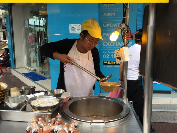 street vendor making fish maw soup