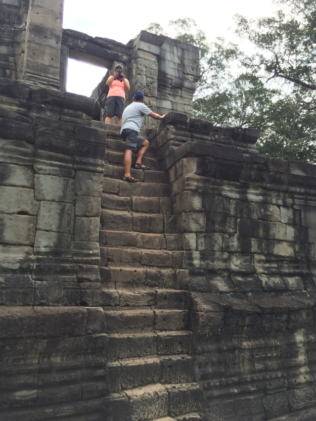 Climbing to the top of Bayon Temple