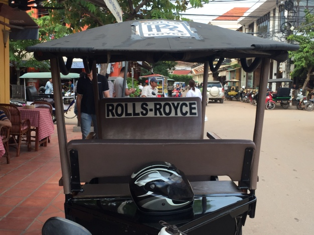 A tuk tuk on one of Siem Reap's main streets