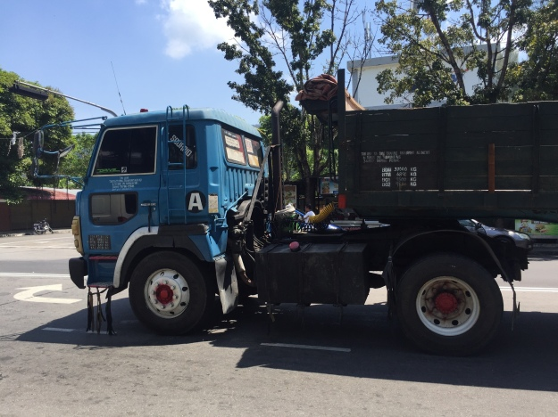 Enormous trucks clog up the two lane street in Batu Ferrenghi every day
